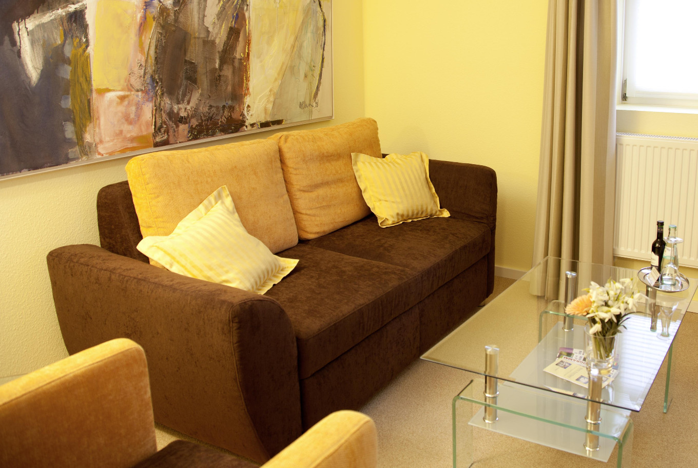 The living area of one of our Arthotel ANA Fleur Apartments