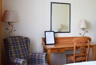 Der Sessel im Zimmer vom ANA Living Munich by Arthotel ANA.